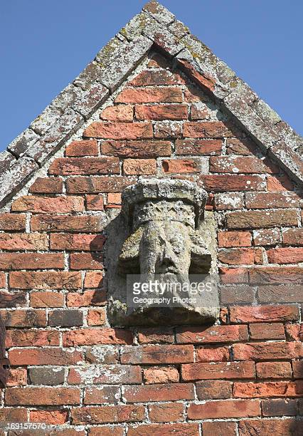 Weathering of medieval limestone carving suggesting effects of acid rain and carbonic acid Covehithe church Suffolk England