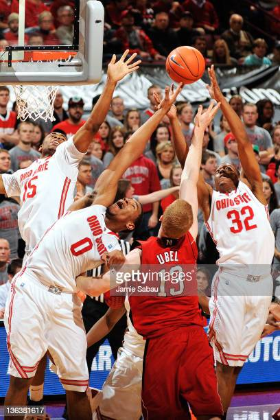 D Weatherspoon Jared Sullinger and Lenzelle Smith Jr #32 all of the Ohio State Buckeyes gang up to take control of a rebound from Brandon Ubel of the...