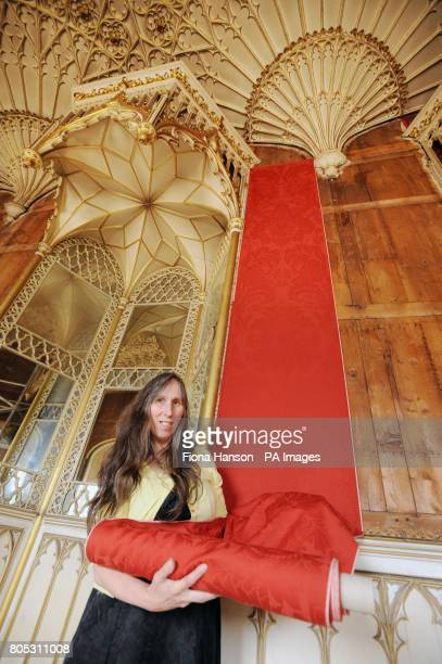 Weaver Anna Benson from Helmshore Lancashire in the 356 metre Long Gallery Strawberry Hill Twickenham Mrs Benson is pictured with a length of damask...