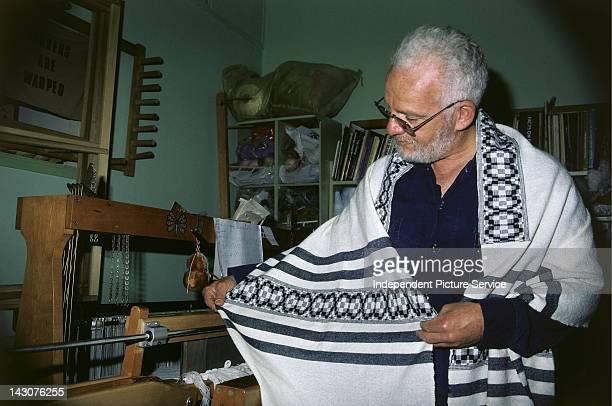 Weaver displaying his work Israel