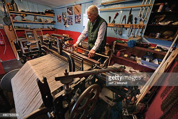 Weaver Norman Mackenzie works on his Hattersley single width loom in the village of Carloway on May 14 2014 in LewisSales in one of Scotlands last...