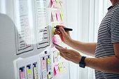 Web designer planning website ux app development with marker pen