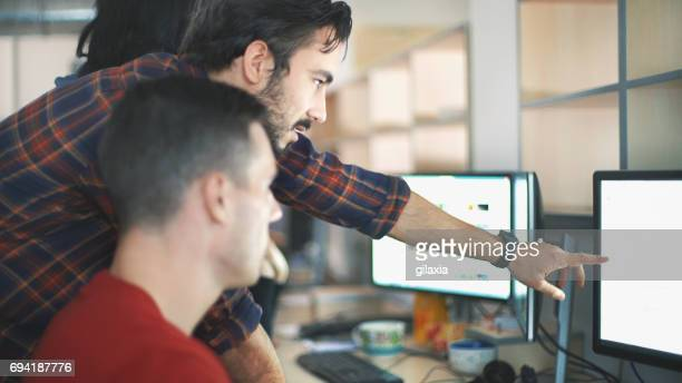 web designers at work. - information technology support stock photos and pictures