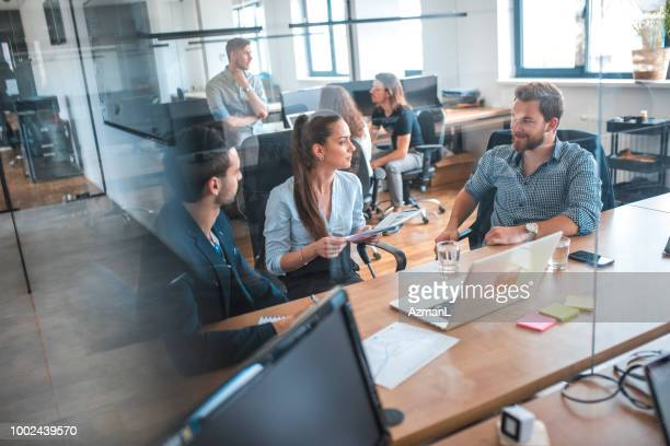 Web designers discussing during meeting in office