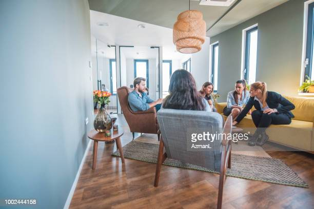 Web designers discussing in lobby at office