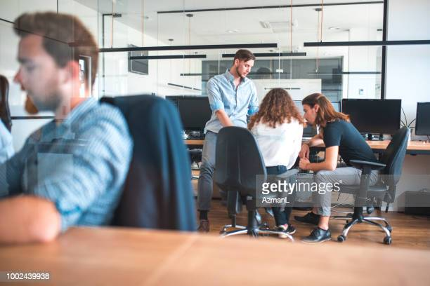 Web designers discussing over project at workplace