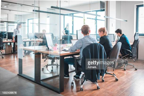 web designers working at desk in creative office - office cubicle stock pictures, royalty-free photos & images