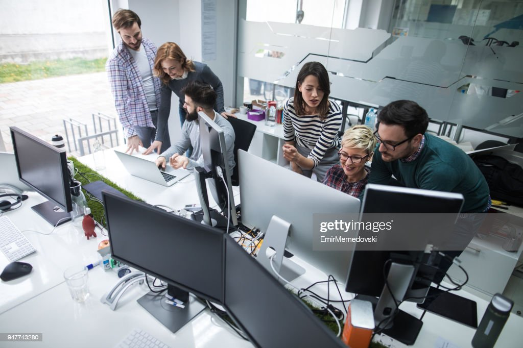 Web designers working in office on project together : Stock Photo