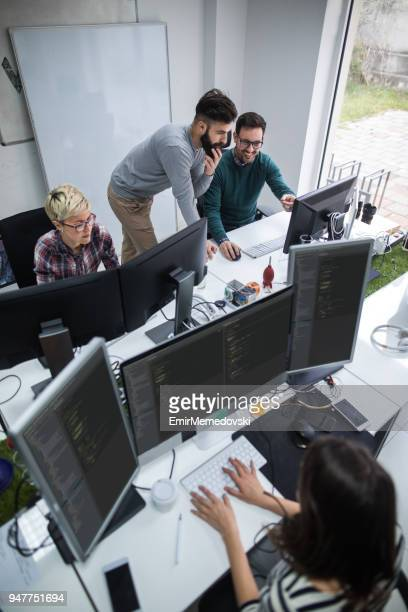 Web designers  working in office on project together