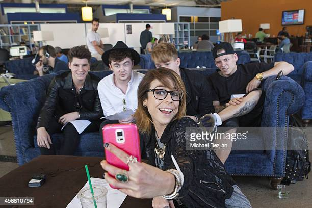 "Web Host Shira Lazar and Rixton band members Charley Bagnall, Jake Roche, Danny Wilkin and Lewi Morgan pose while visiting ""What's Trending"" on..."