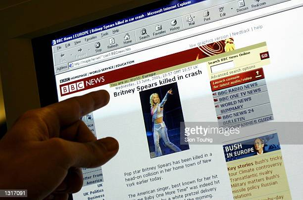 A web surfer looks at a website that falsely identifies itself as 'BBC News' with links connecting it to the real 'BBC News' and reports of the death...