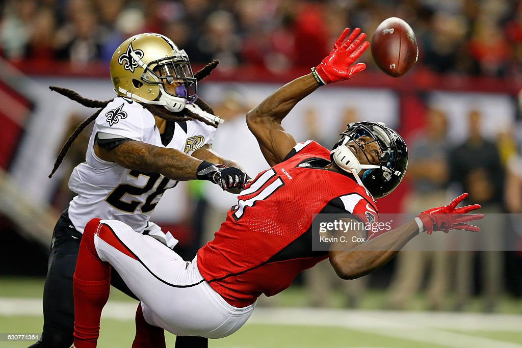 B.W. Webb #28 of the New Orleans Saints breaks up a pass intended for Julio Jones #11 of the Atlanta Falcons during the second half at the Georgia Dome on January 1, 2017 in Atlanta, Georgia.