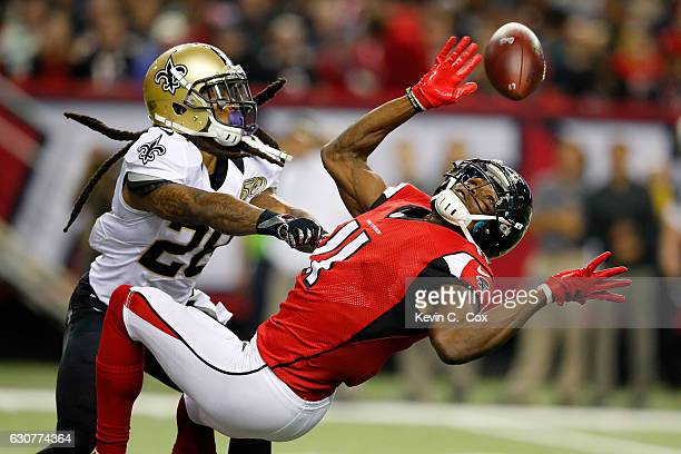 W Webb of the New Orleans Saints breaks up a pass intended for Julio Jones of the Atlanta Falcons during the second half at the Georgia Dome on...