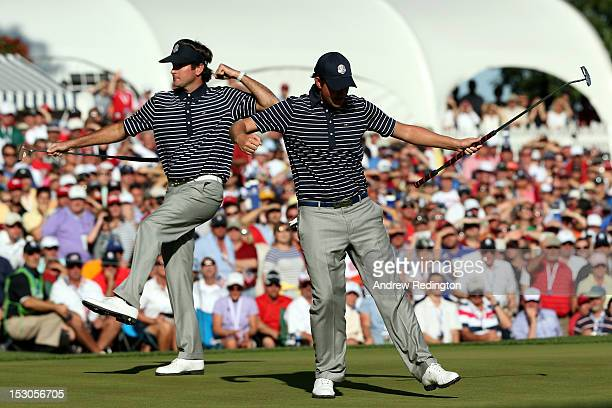 Webb Simpson and Bubba Watson of the USA celebrate Simpson's birdie on the 13th green during day two of the Afternoon Four-Ball Matches for The 39th...