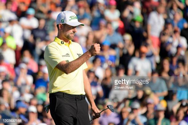 Webb Simpson celebrates after he putts for birdie on the 18th green during the final round of the Waste Management Phoenix Open at TPC Scottsdale on...