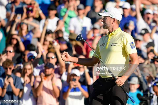 Webb Simpson celebrates after putting for birdie on the first playoff hole during the final round to win the Waste Management Phoenix Open at TPC...