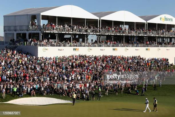 Webb Simpson celebrates after winning the the Waste Management Open on the first playoff hole against Tony Finau at TPC Scottsdale on February 02...