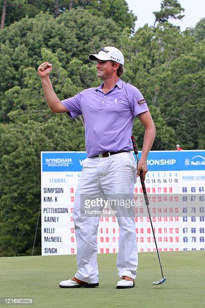 Webb Simpson celebrates on the 18th green after winning the Wyndham Championship at Sedgefield Country Club on August 21, 2011 in Greensboro, North...