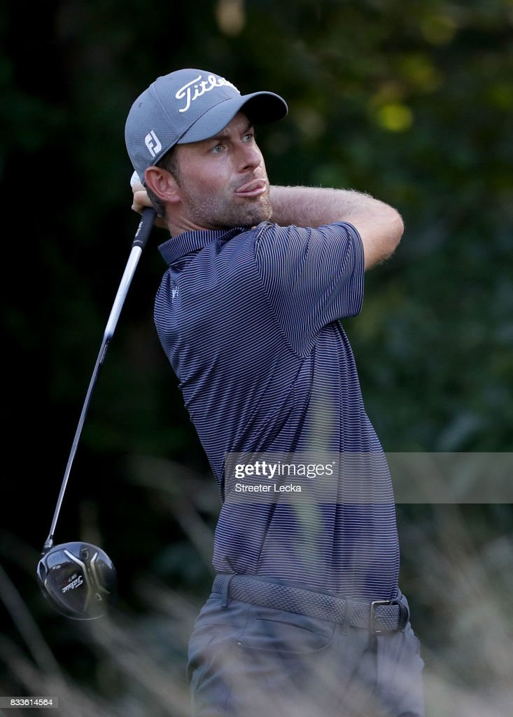 Webb Simpson hits a tee shot on the 13th hole during the first round of the Wyndham Championship at Sedgefield Country Club on August 17, 2017 in Greensboro, North Carolina.