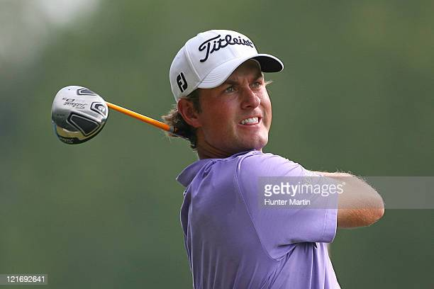 Webb Simpson hits his tee shot on the 13th hole during the final round of the Wyndham Championship at Sedgefield Country Club on August 21, 2011 in...