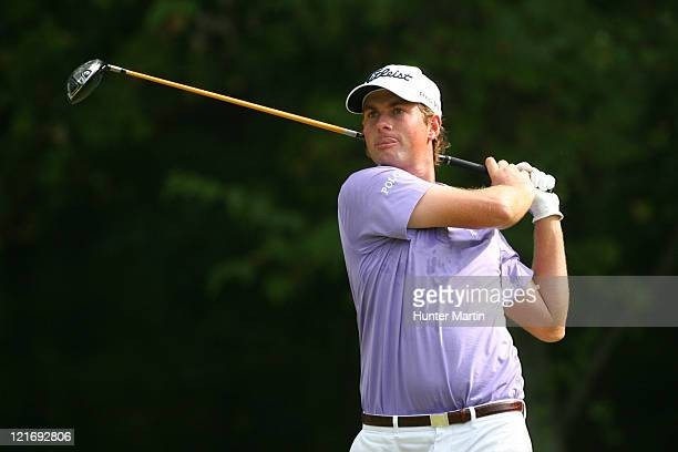 Webb Simpson hits his tee shot on the 14th hole during the final round of the Wyndham Championship at Sedgefield Country Club on August 21, 2011 in...