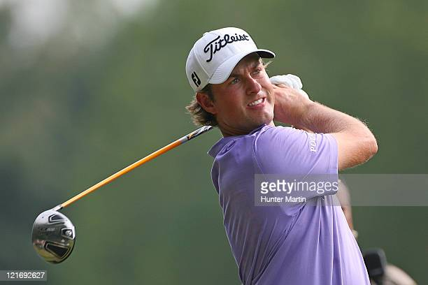 Webb Simpson hits his tee shot on the 15th hole during the final round of the Wyndham Championship at Sedgefield Country Club on August 21, 2011 in...