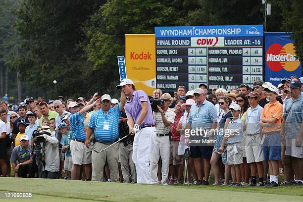 Webb Simpson hits his third shot on the 10th hole during the final round of the Wyndham Championship at Sedgefield Country Club on August 21, 2011 in...