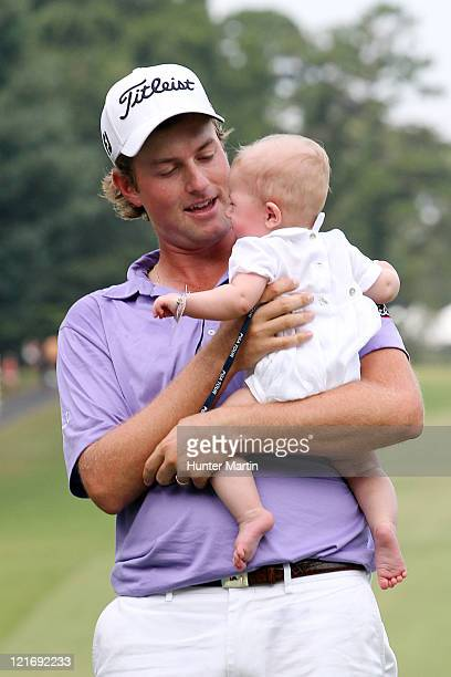 Webb Simpson holds his son James on the 18th green after winning the Wyndham Championship at Sedgefield Country Club on August 21, 2011 in...