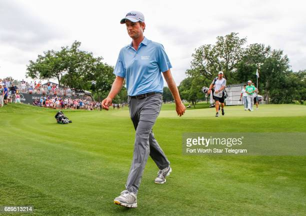 Webb Simpson leaves the 18th green after finishing 5th during the final round of the Dean & DeLuca Invitational golf tournament on Sunday, May 28,...