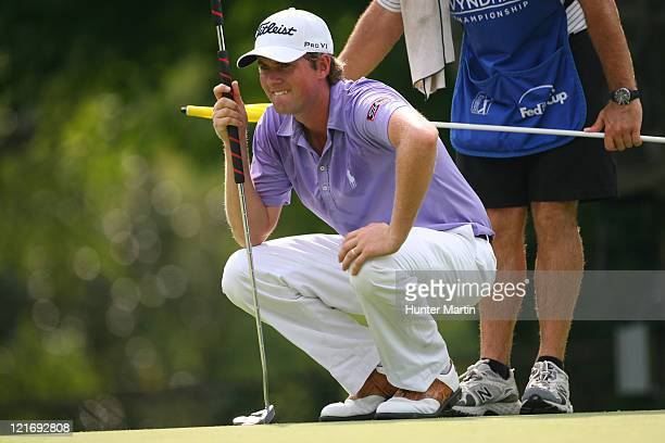 Webb Simpson lines up his birdie putt on the 14th hole during the final round of the Wyndham Championship at Sedgefield Country Club on August 21,...