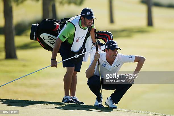 Webb Simpson looks over the tenth green with his caddie Paul Tesori during the third round of the Shriners Hospitals for Children Open at TPC...