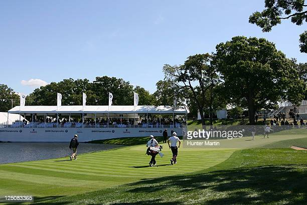 Webb Simpson Matt Kuchar and Dustin Johnson walk up to the 18th green during the first round of the BMW Championship at Cog Hill Golf Country Club on...