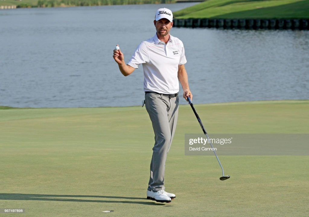 Webb Simpson of the United States acknowledges the crowds on the 18th green after holing out for a course record equalling 10 under par 63 during the second round of the THE PLAYERS Championship on the Stadium Course at TPC Sawgrass on May 11, 2018 in Ponte Vedra Beach, Florida.