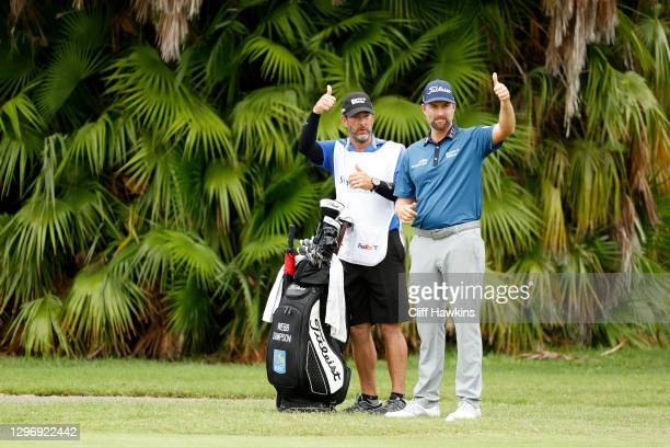 Webb Simpson of the United States and caddie Paul Tesori gesture to Anirban Lahiri of India on the tenth hole during the final round of the Sony Open...