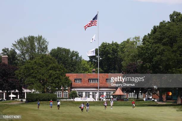 Webb Simpson of the United States and Chris Kirk of the United States walk on the third hole during the third round of the Rocket Mortgage Classic on...