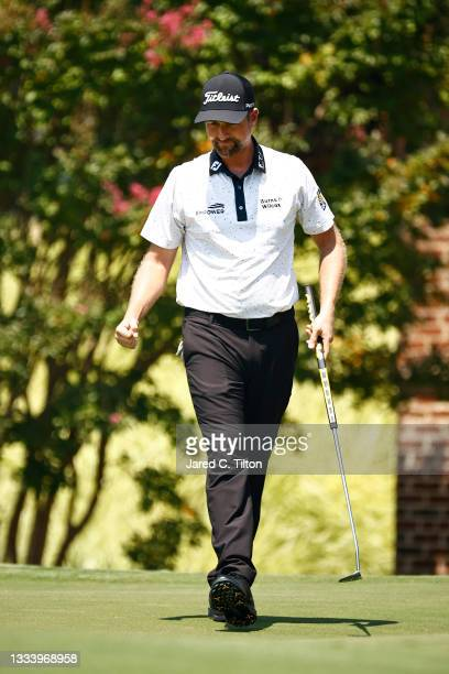 Webb Simpson of the United States celebrates a putt for birdie on the ninth green during the second round of the Wyndham Championship at Sedgefield...
