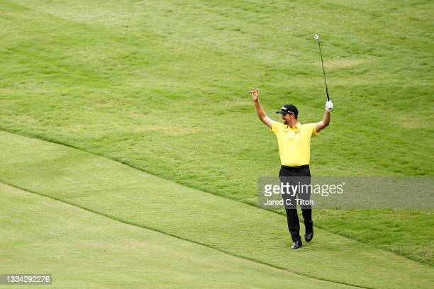 Webb Simpson of the United States celebrates holing out from the 11th fairway during the final round of the Wyndham Championship at Sedgefield...