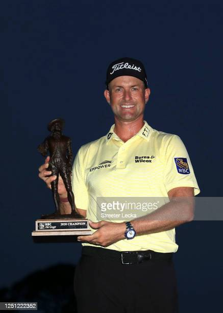 Webb Simpson of the United States celebrates with the trophy after winning during the final round of the RBC Heritage on June 21, 2020 at Harbour...