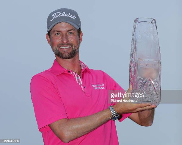 Webb Simpson of the United States celebrates with the winner's trophy after the final round of THE PLAYERS Championship on the Stadium Course at TPC...