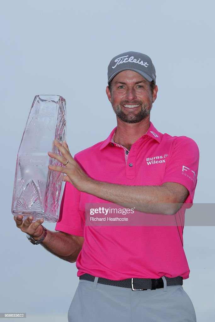 Webb Simpson of the United States celebrates with the winner's trophy after the final round of THE PLAYERS Championship on the Stadium Course at TPC Sawgrass on May 13, 2018 in Ponte Vedra Beach, Florida.