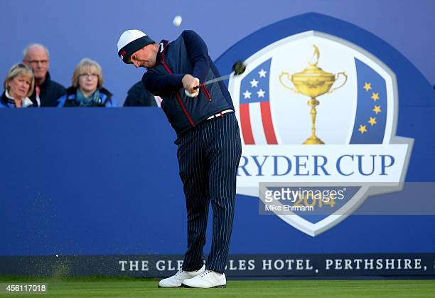 Webb Simpson of the United States hits the opening tee shot during the Morning Fourballs of the 2014 Ryder Cup on the PGA Centenary course at the...
