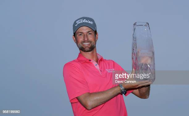 Webb Simpson of the United States holds the trophy after his four stroke victory the final round of the THE PLAYERS Championship on the Stadium...