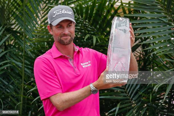 Webb Simpson of the United States holds the Waterford Crystal trophy after winning THE PLAYERS Championship on May 13, 2018 at TPC Sawgrass in Ponte...