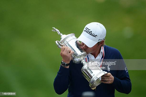 Webb Simpson of the United States kisses the trophy after his onestroke victory at the 112th US Open at The Olympic Club on June 16 2012 in San...