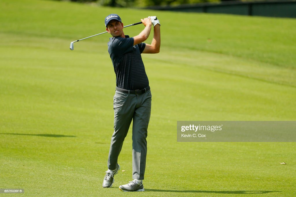 Webb Simpson of the United States plays a shot during the third round of the TOUR Championship at East Lake Golf Club on September 23, 2017 in Atlanta, Georgia.