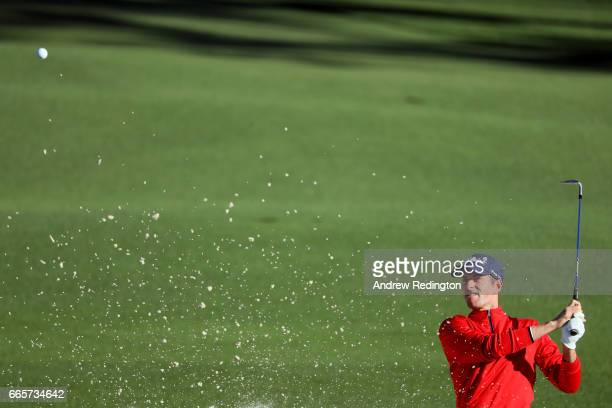 Webb Simpson of the United States plays a shot from a bunker on the second hole during the second round of the 2017 Masters Tournament at Augusta...