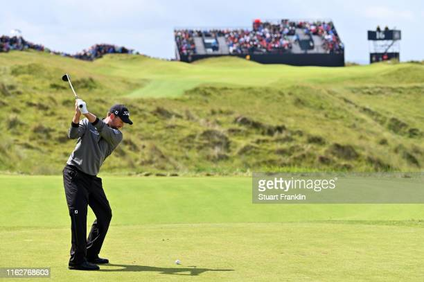 Webb Simpson of the United States plays a shot on the 16th hole during the first round of the 148th Open Championship held on the Dunluce Links at...