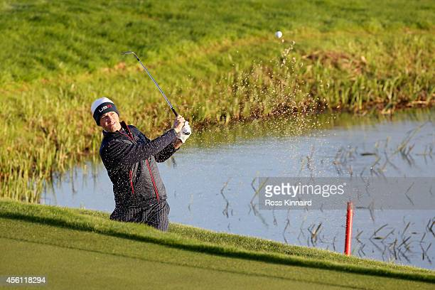 Webb Simpson of the United States plays from a bunker on the 2nd hole during the Morning Fourballs of the 2014 Ryder Cup on the PGA Centenary course...