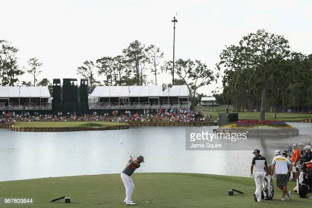 Webb Simpson of the United States plays his shot from the 17th tee during the third round of THE PLAYERS Championship on the Stadium Course at TPC...