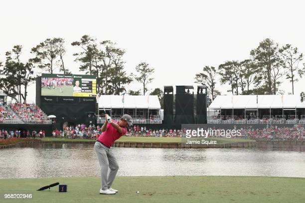 Webb Simpson of the United States plays his shot from the 17th tee during the final round of THE PLAYERS Championship on the Stadium Course at TPC...